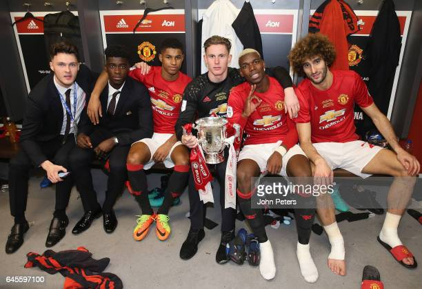 Axel Tuanzebe Marcus Rashford Dean Henderson Paul Pogba and Marouane Fellaini of Manchester United celebrate in the dressing room after the EFL Cup...
