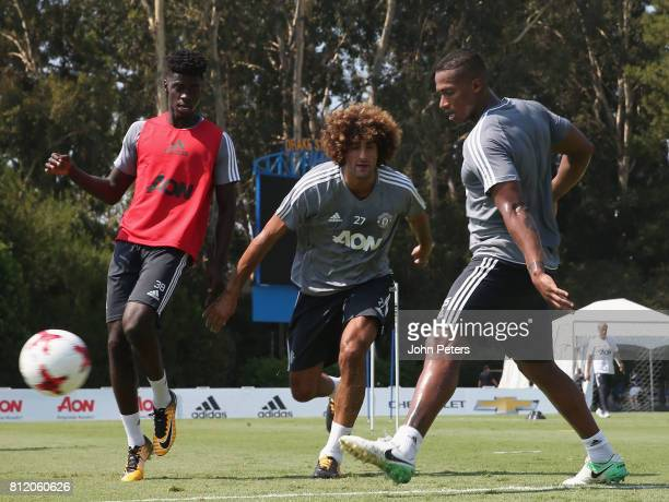 Axel Tuanzebe Marouane Fellaini and Antonio Valencia of Manchester United in action during a first team training session as part of their preseason...