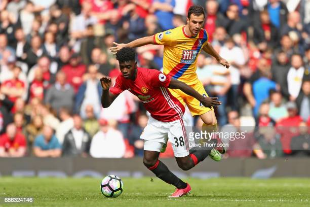 Axel Tuanzebe of Manchesater United and Luka Milivojevic of Crystal Palace in action during the Premier League match between Manchester United and...