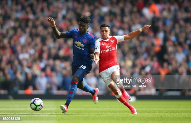 Axel Tuanzebe of Manchester United and Alexis Sanchez of Arsenal during the Premier League match between Arsenal and Manchester United at Emirates...