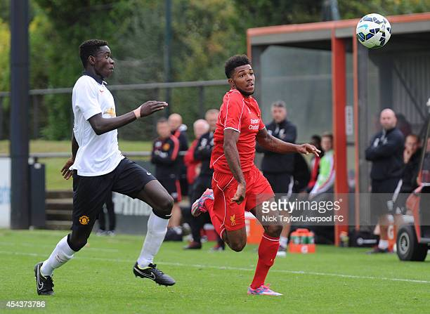 Axel Tuanzebe of Manchester United and Jerome Sinclair of Liverpool in action during the Barclays Premier League Under 18 fixture between Liverpool...