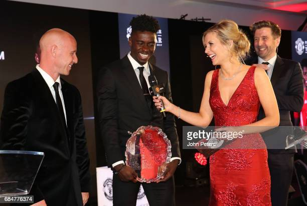 Axel Tuanzebe of Manchester United is interviewed by presenter Rachel Riley at the club's annual Player of the Year awards at Old Trafford on May 18...