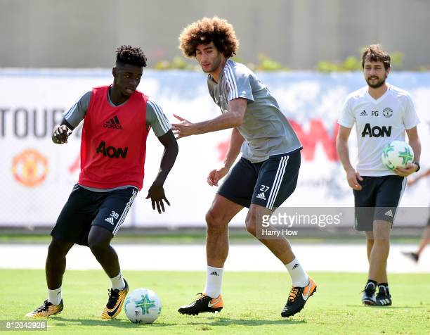 Axel Tuanzebe of Manchester United keeps the ball from Marouane Fellaini during training for Tour 2017 at UCLA's Drake Stadium on July 10 2017 in Los...