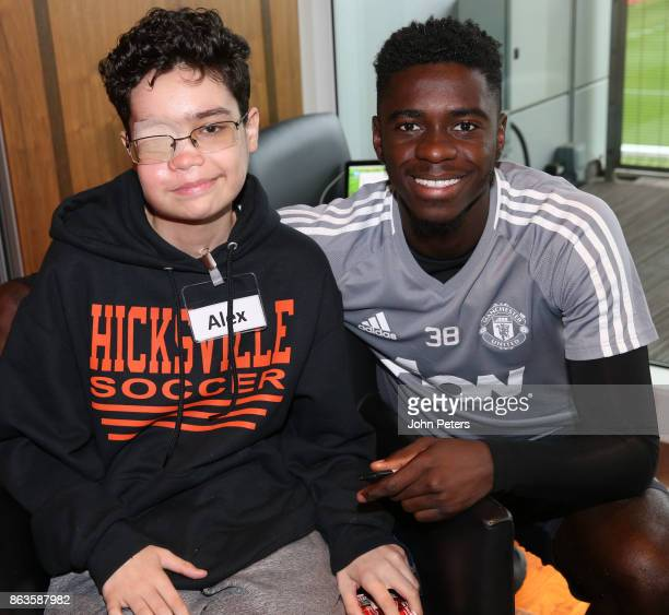 Axel Tuanzebe of Manchester United pose with Alex during a MU Foundation Dream Day at Aon Training Complex on October 20 2017 in Manchester England