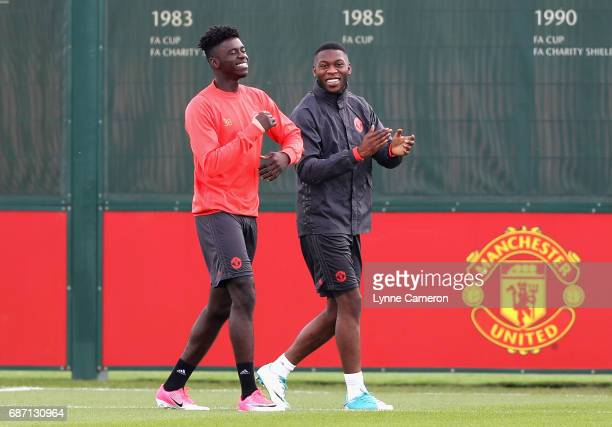 Axel Tuanzebe of Manchester United speaks to Timothy FosuMensah of Manchester United during a Manchester United training session ahead of the UEFA...