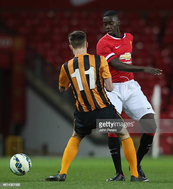Axel Tuanzebe of Manchester United U18s in action with Ben Hinchcliffe of Hull City U18s during the FA Youth Cup Fourth Round match between...