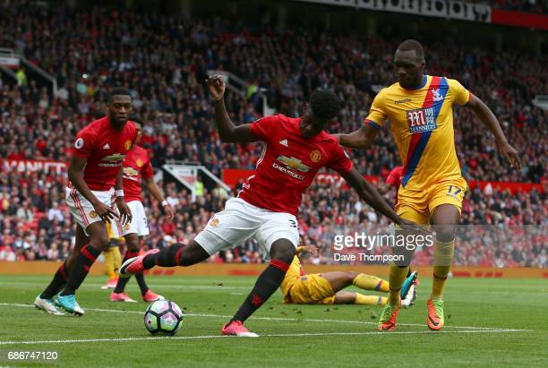 Axel Tuanzebe of Manchester United wins the ball ahead of Christian Benteke of Crystal Palace during the Premier League match between Manchester...
