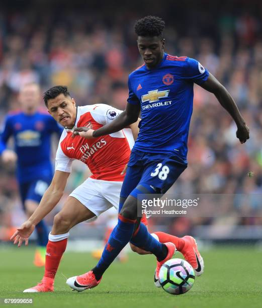 Axel Tuanzebe ofManchester United is put under pressure from Alexis Sanchez of Arsenal during the Premier League match between Arsenal and Manchester...