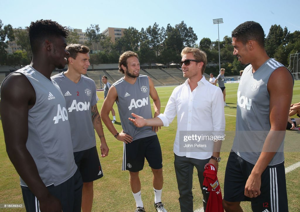 Axel Tuanzebe, Victor Lindelof and Daley Blind and Chris Smalling of Manchester United meet Formula One world champion Nico Rosberg ahead of a first team training session as part of their pre-season tour of the USA at UCLA on July 18, 2017 in Los Angeles, California.