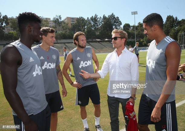 Axel Tuanzebe Victor Lindelof and Daley Blind and Chris Smalling of Manchester United meet Formula One world champion Nico Rosberg ahead of a first...