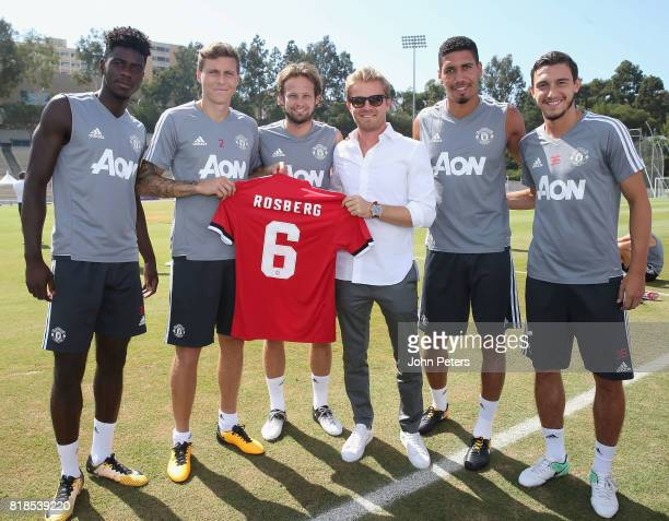 Axel Tuanzebe Victor Lindelof and Daley Blind Chris Smalling and Matteo Darmian of Manchester United present Formula One world champion Nico Rosberg...