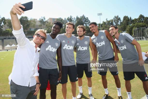 Axel Tuanzebe Victor Lindelof and Daley Blind Chris Smalling and Matteo Darmian of Manchester United take a selfie with Formula One world champion...