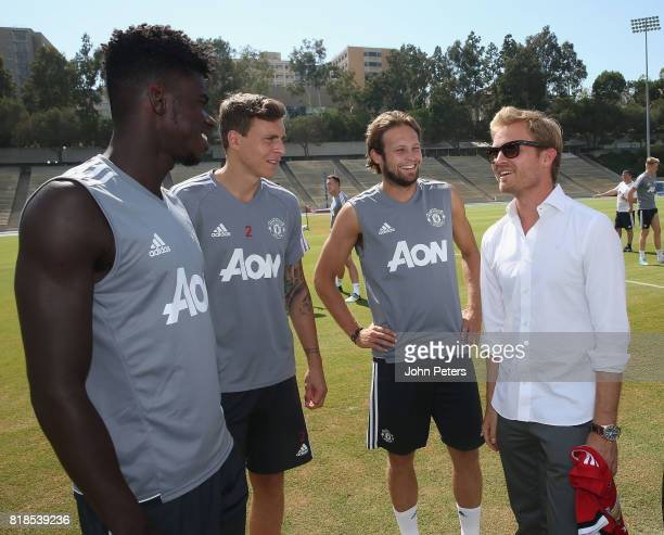 Axel Tuanzebe Victor Lindelof and Daley Blind of Manchester United meet Formula One world champion Nico Rosberg ahead of a first team training...