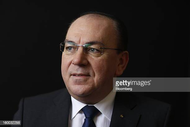 Axel Weber chairman of UBS AG poses for a photograph following a Bloomberg Television interview on day three of the World Economic Forum in Davos...