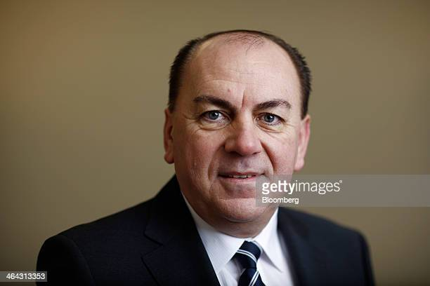 Axel Weber chairman of UBS AG poses for a photograph following a Bloomberg Television interview on the opening day of the World Economic Forum in...