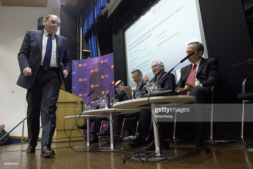 Axel Weber, chairman of UBS AG, returns to his seat after speaking during a financial and economic event at the London School of Economics (LSE) in London, U.K., on Monday, March 25, 2013. The European Union's decision to recapitalize Cypriot banks by inflicting losses on depositors and senior bondholders is triggering investor concern about the knock-on effects for bank funding across the region. Photographer: Jason Alden/Bloomberg via Getty Images