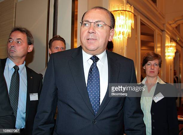 Axel Weber president of the Deutsche Bundesbank center arrives for the Banks in Crisis conference in Frankfurt Germany on Wednesday Sept 8 2010...