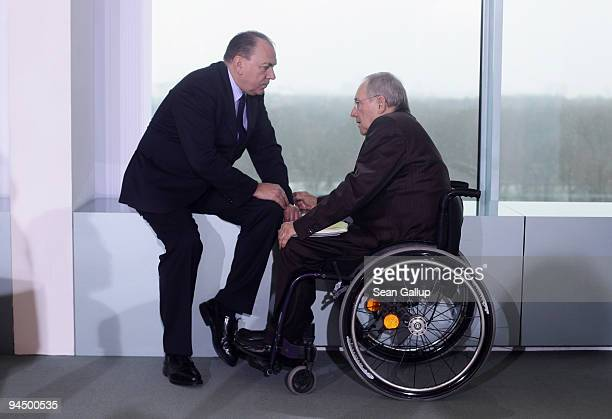 Axel Weber President of the German Bundesbank chats with Finance Minister Wolfgang Schaeuble as they arrive for the weekly German government cabinet...