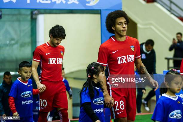 Axel Witsel and Alexandre Pato of Tianjin Quanjian walk on to the pitch prior to the 2nd round match of CSL Chinese Football Association between...