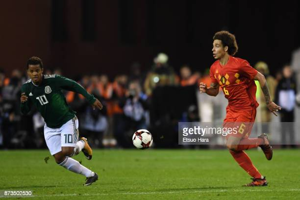 Axel Witsel of Belgium and Giovani Dos Santos compete for the ball during the international friendly match between Belgium and Mexico at King...
