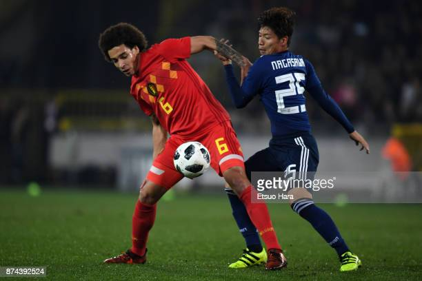 Axel Witsel of Belgium and Kazuki Nagasawa of Japan compete for the ball during the international friendly match between Belgium and Japan at Jan...
