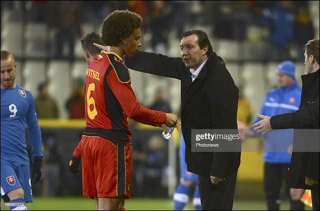 Axel Witsel of Belgium and <a gi-track='captionPersonalityLinkClicked' href=/galleries/search?phrase=Marc+Wilmots&family=editorial&specificpeople=1016207 ng-click='$event.stopPropagation()'>Marc Wilmots</a> head coach of Belgian Team during a FIFA international friendly match in preparation of the World Cup qualifying round between Belgium and Slovakia at the Jan Breydel stadium on February 6, 2013 in Brugge, Belgium