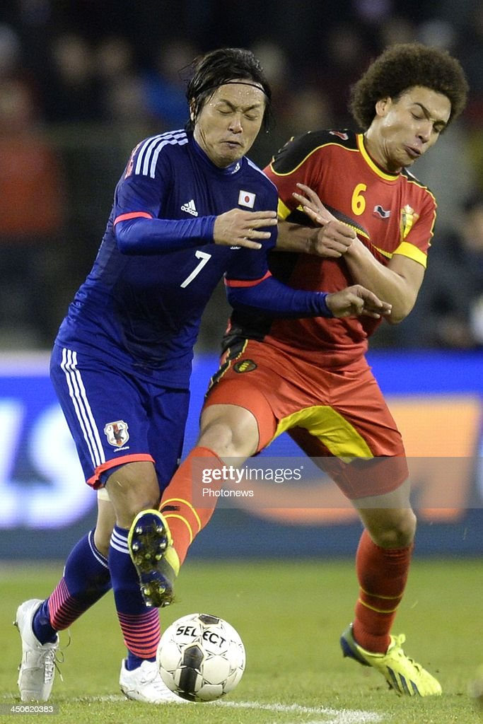 Axel Witsel of Belgium battles for the ball with Endo Yasuhito of Japan during the international friendly match before the World Cup in Brasil between Belgium and Japan on November 19, 2013 in Brussels, Belgium