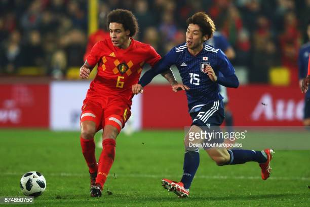 Axel Witsel of Belgium battles for the ball with Yuya Osako of Japan during the international friendly match between Belgium and Japan held at Jan...