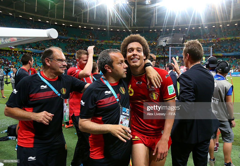 <a gi-track='captionPersonalityLinkClicked' href=/galleries/search?phrase=Axel+Witsel&family=editorial&specificpeople=4345455 ng-click='$event.stopPropagation()'>Axel Witsel</a> of Belgium celebrate the 2-1 win with his team staffs after the 2014 FIFA World Cup Brazil Round of 16 match between Belgium and USA at Arena Fonte Nova on July 1, 2014 in Salvador, Brazil.
