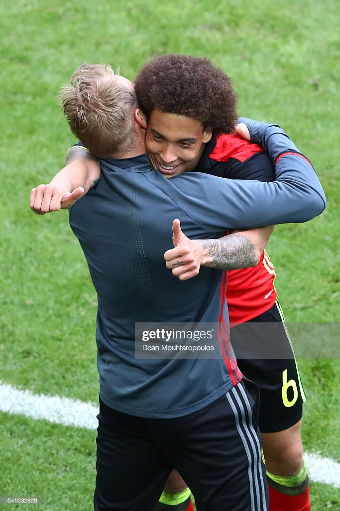 <a gi-track='captionPersonalityLinkClicked' href=/galleries/search?phrase=Axel+Witsel&family=editorial&specificpeople=4345455 ng-click='$event.stopPropagation()'>Axel Witsel</a> of Belgium celebrates with <a gi-track='captionPersonalityLinkClicked' href=/galleries/search?phrase=Marc+Wilmots&family=editorial&specificpeople=1016207 ng-click='$event.stopPropagation()'>Marc Wilmots</a> manager of Belgium after he scores his team's second goal during the UEFA EURO 2016 Group E match between Belgium and Republic of Ireland at Stade Matmut Atlantique on June 18, 2016 in Bordeaux, France.