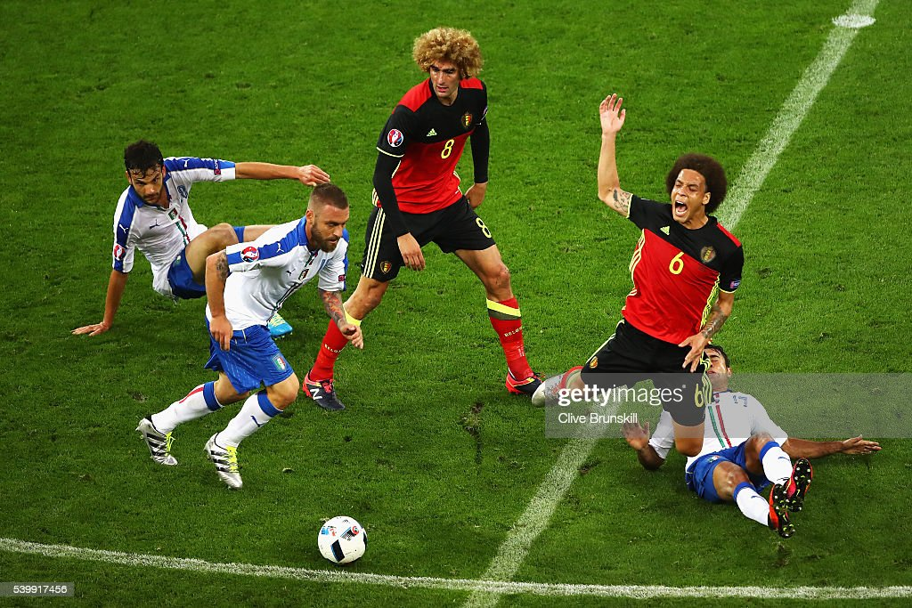 <a gi-track='captionPersonalityLinkClicked' href=/galleries/search?phrase=Axel+Witsel&family=editorial&specificpeople=4345455 ng-click='$event.stopPropagation()'>Axel Witsel</a> (2nd R) of Belgium is fouled by Eder (1st R) of Italy during the UEFA EURO 2016 Group E match between Belgium and Italy at Stade des Lumieres on June 13, 2016 in Lyon, France.