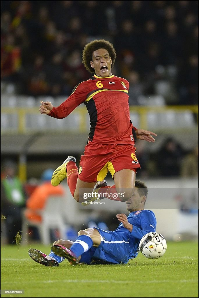 Axel Witsel of Belgium is tackled by Michal Duris of Slovakia during a FIFA international friendly match between Belgium and Slovakia at theJan Breydel stadium on February 06, 2013 in Brugge, Belgium.