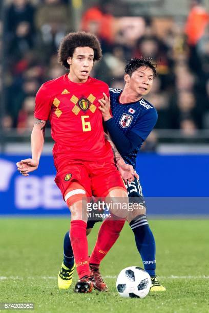 Axel Witsel of Belgium Kazuki Nagasawa of Japan during the friendly match between Belgium and Japan on November 14 2017 at the Jan Breydel stadium in...