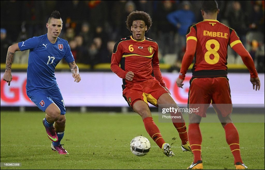 Axel Witsel of Belgium passes the ball during a FIFA international friendly match in preparation of the World Cup qualifying round between Belgium and Slovakia at the Jan Breydel stadium on February 6, 2013 in Brugge, Belgium