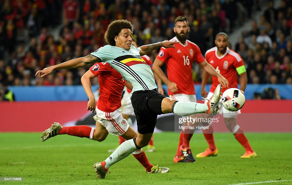<a gi-track='captionPersonalityLinkClicked' href=/galleries/search?phrase=Axel+Witsel&family=editorial&specificpeople=4345455 ng-click='$event.stopPropagation()'>Axel Witsel</a> of Belgium stretches for the ball during the UEFA EURO 2016 quarter final match between Wales and Belgium at Stade Pierre-Mauroy on July 1, 2016 in Lille, France.