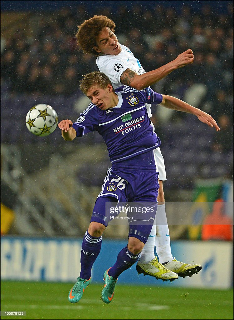 Axel Witsel of FC Zenit St Petersburg (top) and Dennis Praet of RSC Anderlecht compete for a high ball during the UEFA Champions League Group C match between RSC Anderlecht and FC Zenit St Petersburg at the Constant Vanden Stock Stadium on November 6, 2012 in Brussels, Belgium.