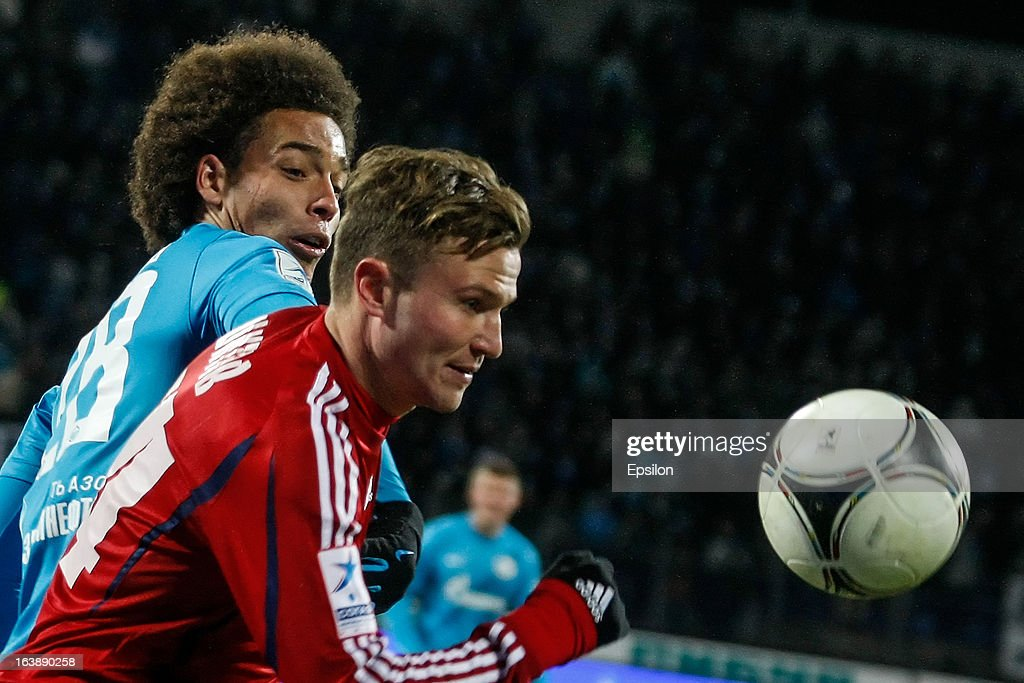 Axel Witsel of FC Zenit St. Petersburg (L) and Igor Shitov of FC Mordovia Saransk vie for the ball during the Russian Football League Championship match between FC Zenit St. Petersburg and FC Mordovia Saransk at the Petrovsky Stadium on March 17, 2013 in St. Petersburg, Russia.
