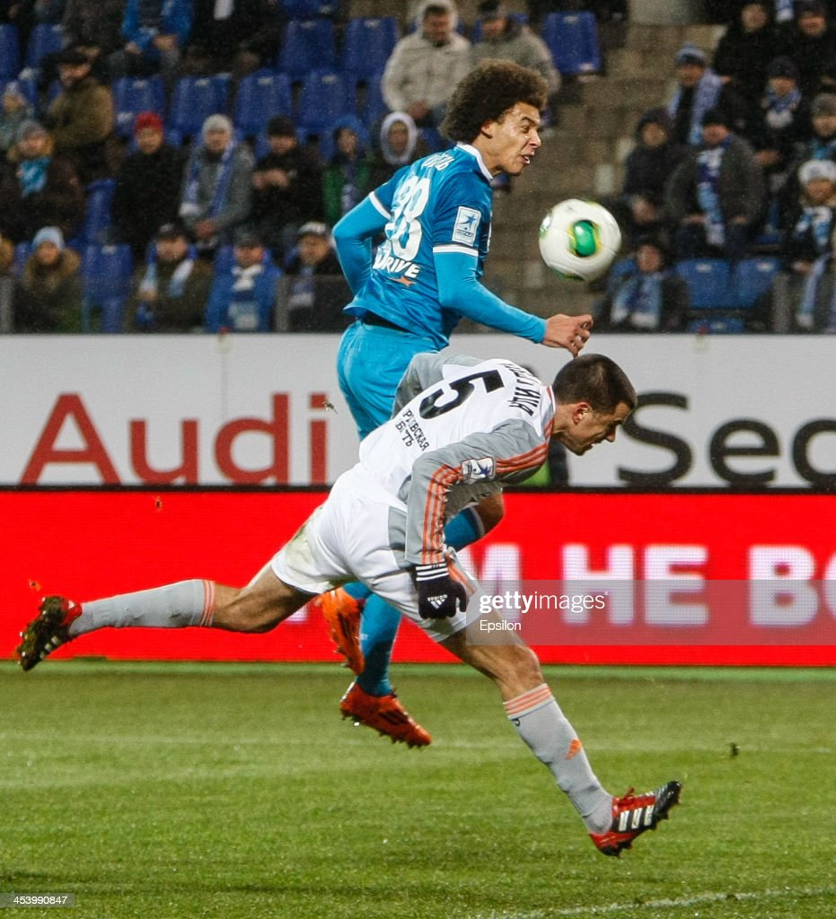 Axel Witsel of FC Zenit St. Petersburg (top) competes for the ball with Milan Vjestica of FC Ural Sverdlovsk Oblast during the Russian Football League Championship match between FC Zenit St. Petersburg and FC Ural Sverdlovsk Oblast at the Petrovsky stadium on December 6, 2013 in St. Petersburg, Russia.