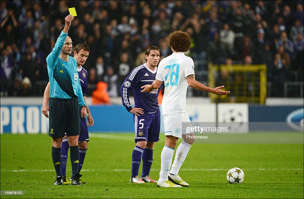 Axel Witsel of FC Zenit St Petersburg (R) gestures as he is shown a yellow card by referee Anthony Gautier during the UEFA Champions League Group C match between RSC Anderlecht and FC Zenit St Petersburg at the Constant Vanden Stock Stadium on November 6, 2012 in Brussels, Belgium.