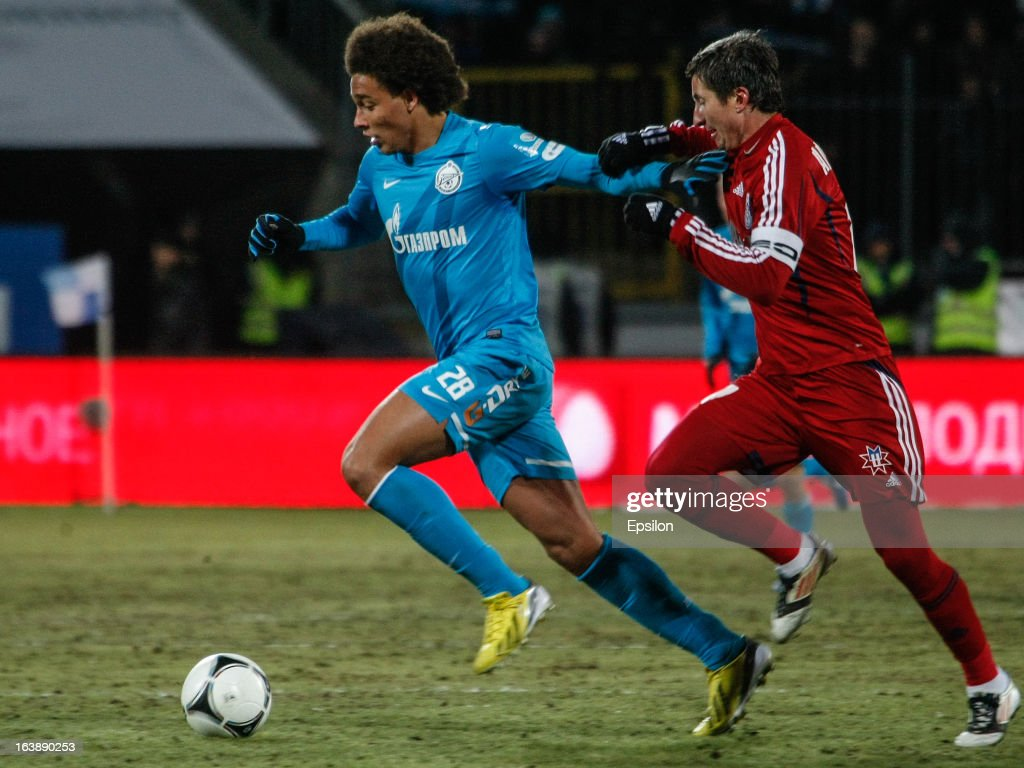 Axel Witsel of FC Zenit St. Petersburg (L) vies for the ball with Evgeni Aldonin of FC Mordovia Saransk during the Russian Football League Championship match between FC Zenit St. Petersburg and FC Mordovia Saransk at the Petrovsky Stadium on March 17, 2013 in St. Petersburg, Russia.