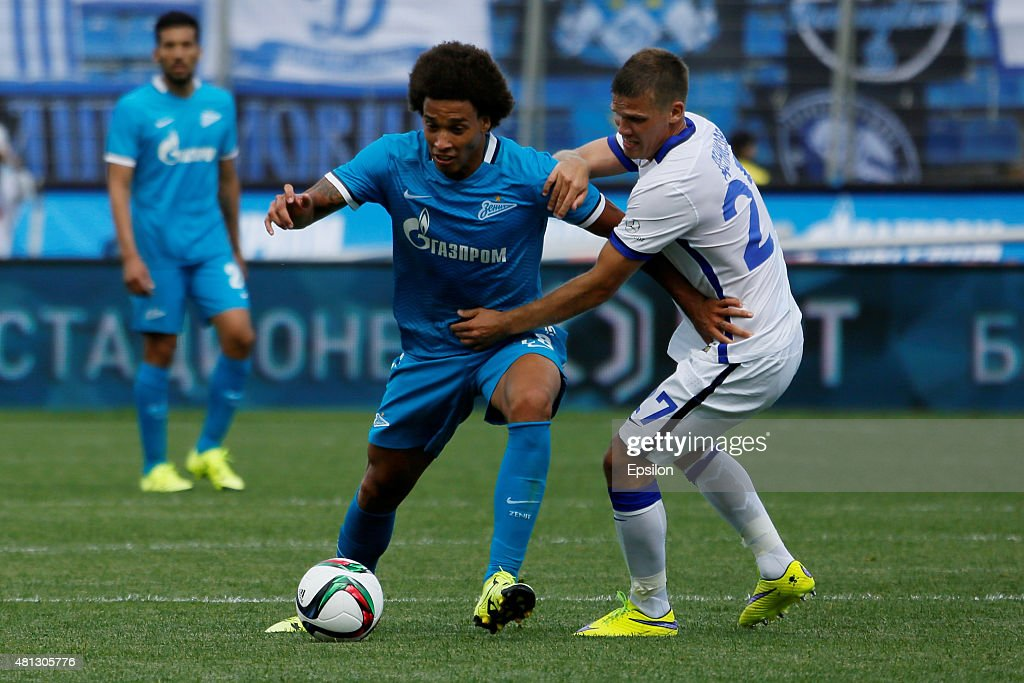 Axel Witsel (C) of FC Zenit St. Petersburg vies for the ball with Igor Denisov of FC Dinamo Moscow during the Russian Football League match between FC Zenit St. Petersburg and FC Dinamo Moscow at the Petrovsky stadium on July 19, 2015 in St. Petersburg, Russia.