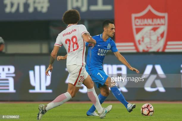 Axel Witsel of Tianjin Quanjian and Eran Zahavi of Guangzhou RF compete for the ball during the 16th round match of 2017 Chinese Football Association...