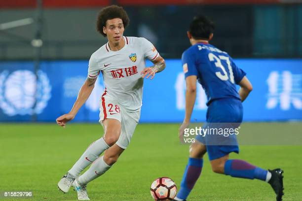 Axel Witsel of Tianjin Quanjian and Sun Shilin of Shanghai Shenhua compete for the ball during the 17th round match of 2017 Chinese Football...