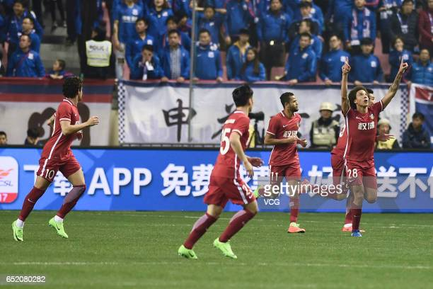 Axel Witsel of Tianjin Quanjian celebrates after scoring his team's first goal during the 2nd round match of CSL Chinese Football Association between...