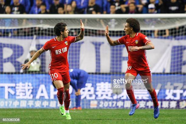 Axel Witsel of Tianjin Quanjian celebrates with Alexandre Pato after scoring his team's first goal during the 2nd round match of CSL Chinese Football...