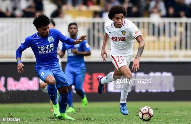 Axel Witsel of Tianjin Quanjian controls the ball during the Chinese Super League match against Guangzhou RF in Guangzhou south China's Guangdong...