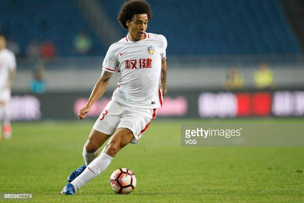 Axel Witsel of Tianjin Quanjian drives the ball during the 10th round match of 2017 Chinese Football Association Super League between Chongqing Lifan...