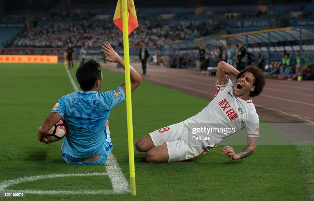 Axel Witsel of Tianjin Quanjian FC (right) reacts after a clash with Boyu Yang of Jiangsu Suning FC (left) during the Chinese Super League match between Jiangsu Suning FC and Tianjin Quanjian FC at Nanjing Olympic Stadium on SEPTEMBER 28, 2017 in Nanjing, China.