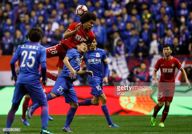 Axel Witsel of Tianjin Quanjian jumps to head the ball during the 2nd round match of CSL Chinese Football Association between Shanghai Shenhua and...
