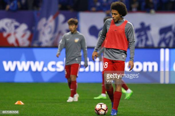 Axel Witsel of Tianjin Quanjian warms up prior to the 2nd round match of CSL Chinese Football Association between Shanghai Shenhua and Tianjin...